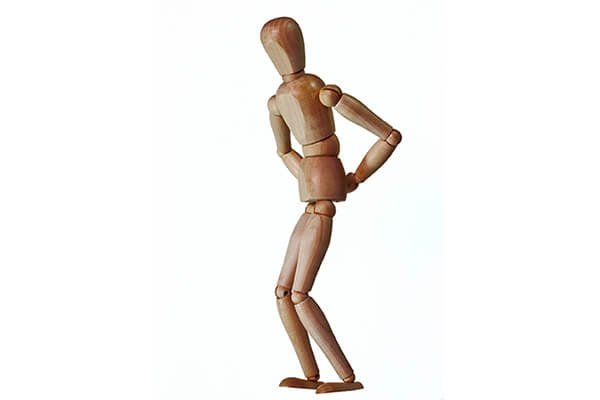IMAGE - Wooden man with back pain