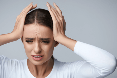 IMAGE - woman with migraine