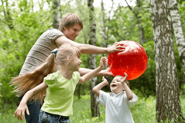 IMAGE: Family playing outdoors