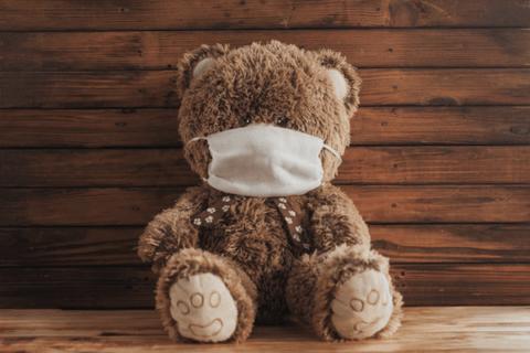 Teddy bear wearing face mask